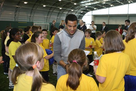Theo Walcott helps to launch the Arsenal Community programme