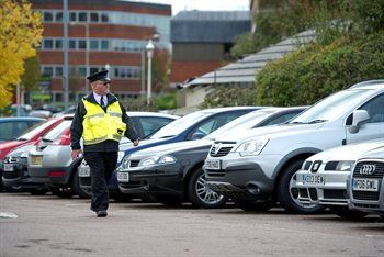 A civil enforcement officer patrols one of our car parks