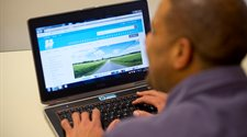 A photograph of a man searching the council website